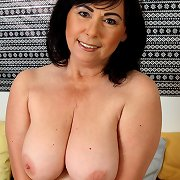 Big tits old woman amateur fingers her pussy.