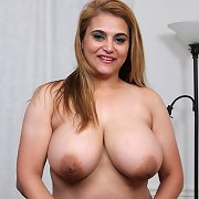 Charming cougar BBW strips to play with dildo